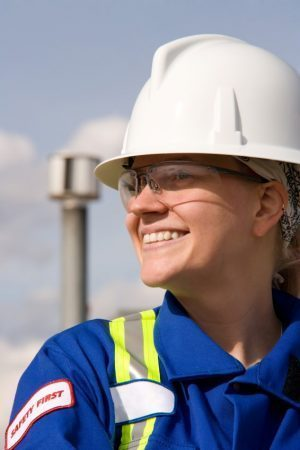 smiling worker with a white hard hat